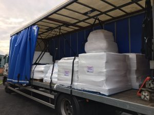 polythene sheets being delivered